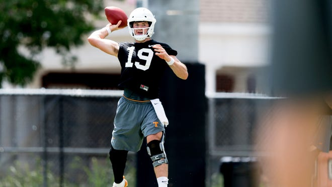 Tennessee quarterback Keller Chryst (19) looks to pass during Tennessee Vols football practice at Haslam Field in Knoxville, Tennessee on Saturday, August 4, 2018.