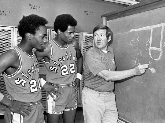 Coach Charlie Anderson, right, talks with Stratford guards William Griffey, left, and Walter Jordan on Jan. 13, 1975.