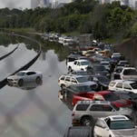 Vehicles left stranded on a flooded Interstate 45 in Houston, Texas.
