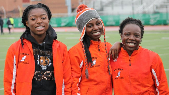 Withrow sophomore J'Alyiea Smith, junior Markeita Beckum and sophomore Angel Prince stay busy in multiple events for the Lady Tigers.