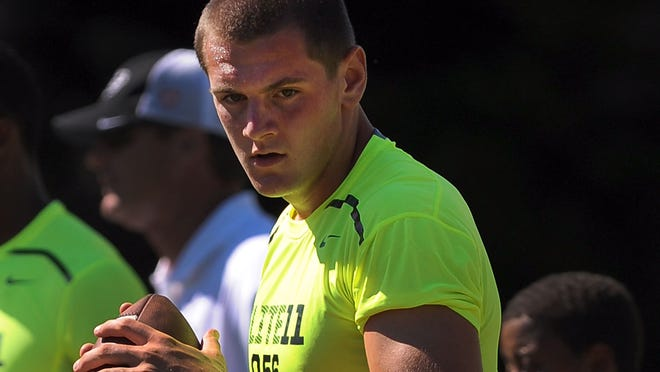 Keller Chryst of Palo Alto, Calif. goes through drills during the afternoon session of the Elite 11 camp on June 29 at Nike World Headquarters.