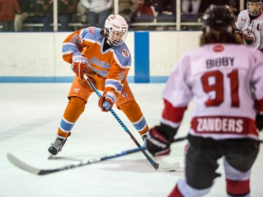 Detroit Little Caesars' Jacob Truscott maneuvers the puck down ice during a Bantam AAA Silver Stick hockey game Friday, Jan. 13, 2017 at Glacier Pointe in Port Huron Township.
