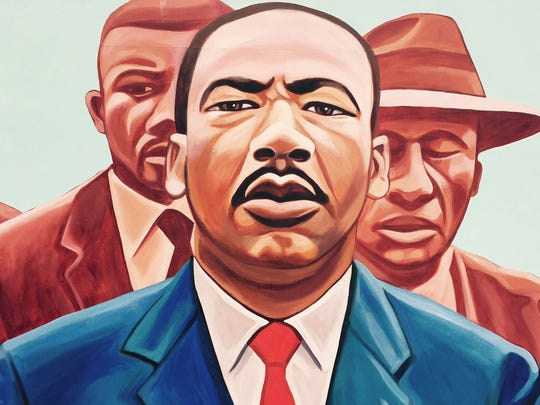 A Martin Luther king mural is seen on MLK street in Indianapolis.