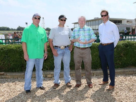 Ellis Park owner Ron Geary (second from right) and racing secretary Dan Bork (far right) present the winning owners title to Ruston Jennings (far left) and J.R. Caldwell (second from left) of Mongo Racing..