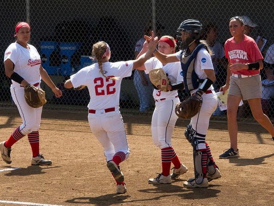 The Southern Indiana Screaming Eagles high-five senior Mena Fulton at the end of an inning. USI beat North Georgia 1-0 to clinch its first World Series win in program history.