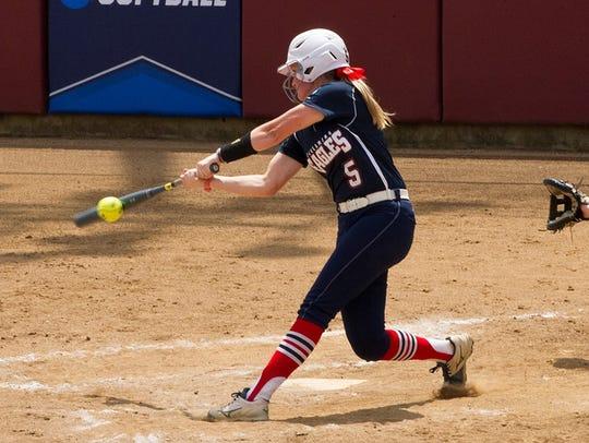 Allison Schubert swings during USI's 3-0 win over Angelo