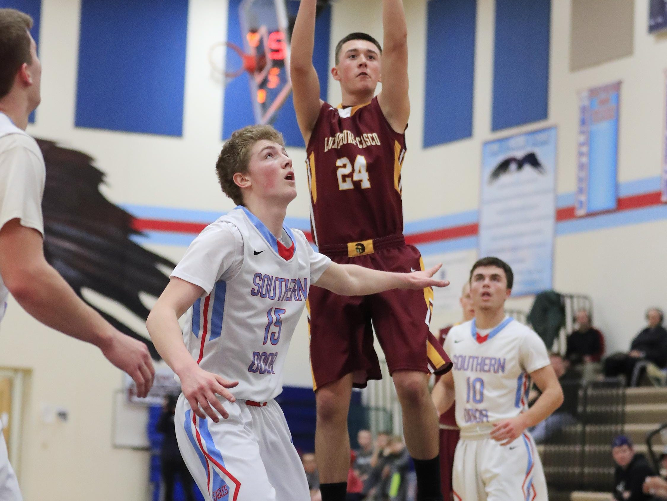 Luxemburg-Casco's Bryce Te Kulve (24) shoots over Southern Door's Kyle Daoust (15) in a boys basketball game Monday.