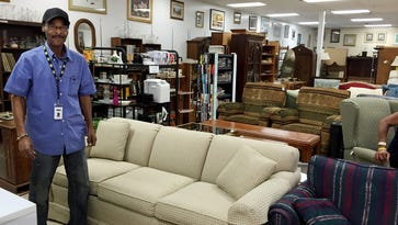 Ted Thompson shows off Operation Stand Down's 12th Avenue Thrift Shop, which has lots of furniture and household items.