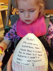 Philadelphia Eagles defensive end Steven Means gave his team-issued Super Bowl football to Ruby Hoffman, a York County toddler battling a rare brain disease.