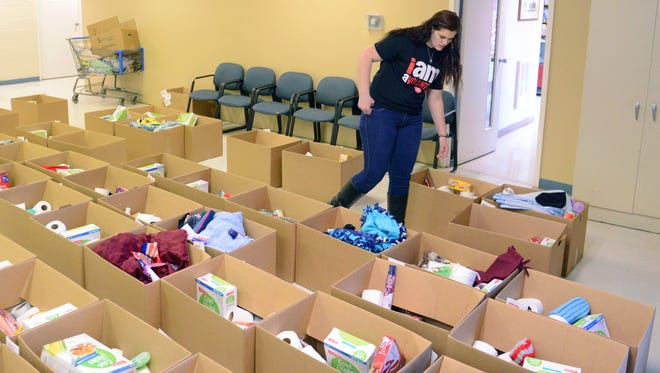 """Tori Dennis, 17, West Muskingum and Mid-East Career and Technology Center student, searches for a """"blessing box"""" for a family in need Friday at the Zanesville Salvation Army."""