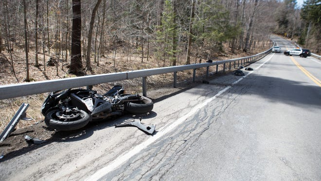 A male and female were taken to Strong Memorial Hospital with serious and possibly life-threatening injuries after their motorcycle crashed into a guardrail on Lake Road in Webster on Sunday, April 19, 2015.