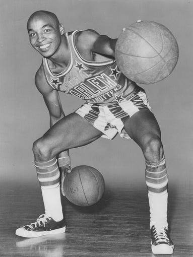 Harlem Globetrotter Curly Neal, shown here in 1972, was always a fan favorite.