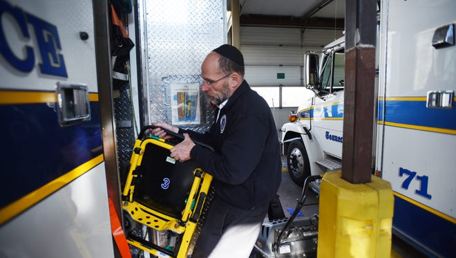 Daniel Senter, former President and Trustee, sorts out equipment at Teaneck Ambulance Corp in Teaneck on 04/26/18. Towns across North Jersey are having trouble finding volunteers to fill the ranks of their fire department and ambulance squads.