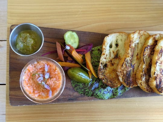 The salmon jar starter at Ojai Harvest features applewood-smoked salmon in a canning jar, with accompaniments that include mezcal-green tomato jam, pickles and crostini.