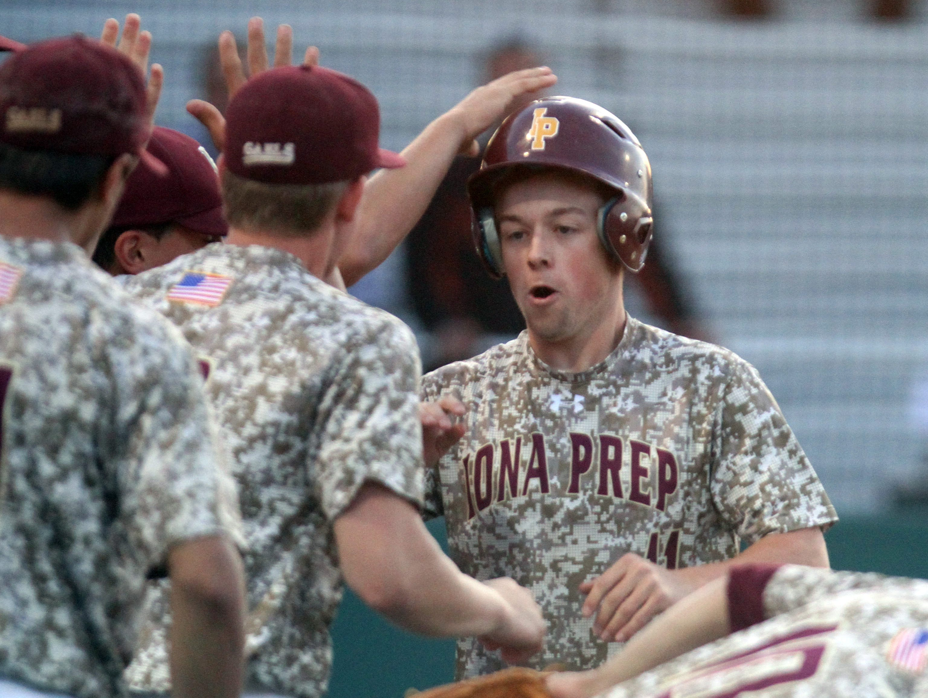 "Iona Prep's Billy Gerken is congratulated after scoring a run in the first inning against Msgr. Farrell during the CHSAA ""AA"" baseball championship final at St. John's University in Queens June 10, 2016."