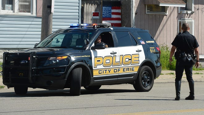 Erie Bureau of Police officers are shown Saturday at 554 E. 12th St. in Erie. The police were investigating a shooting that occurred around 10 a.m. in the 700 block of East 25th Street. A male was taken to the hospital with non-life threatening injuries.