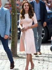 Duchess Kate wears a pale pink knee-length dress from