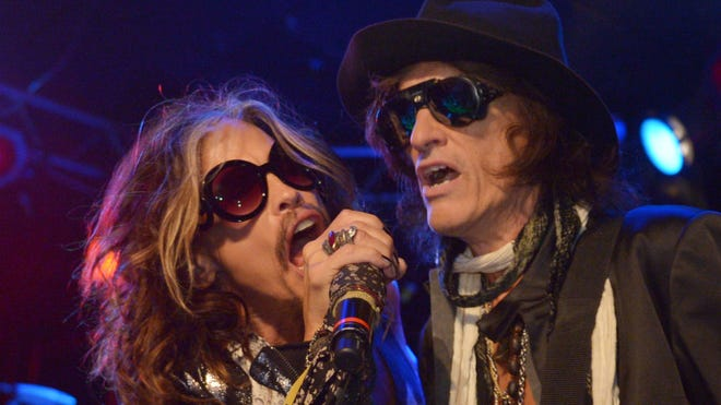 Steven Tyler, left, and Joe Perry of Aerosmith perform at the Whisky A Go Go on April 8, 2014, in Los Angeles.