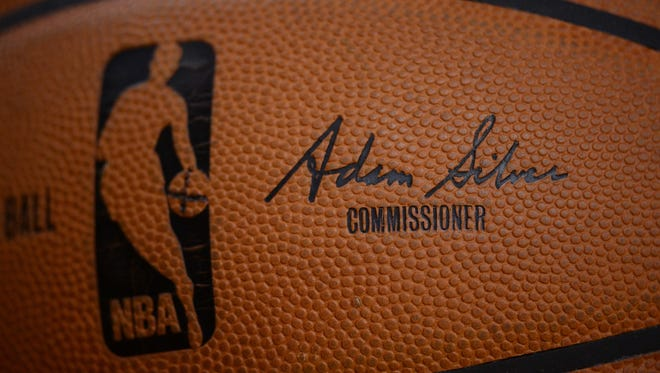 A detailed view of an NBA basketball with commissioner Adam Silver's signature.