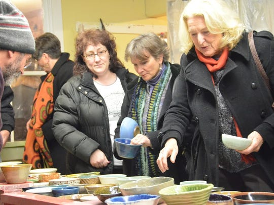 The Empty Bowl Benefit last year raised $10,000 for the Vermont Foodbank. In this picture, people are picking a bowl to fill with soup. This year's benefit is Feb. 13 in Middlesex.