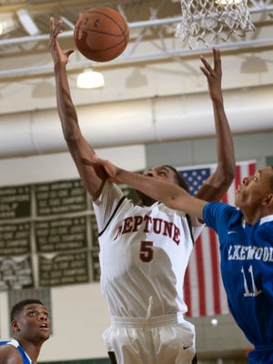 Neptune's Marcque Ellington outreaches Lakewood's Sean Barksdale for a rebound during second half action. Lakewood vs Neptune boys basketball in Hoop Group Showcase in Long Branch, NJ on January 10, 2015. Peter Ackerman/Staff Photographer