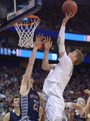 March 18, 2017: Arizona Wildcats forward Lauri Markkanen (10) moves to the basket against Saint Mary's Gaels forward Dane Pineau (22) during the second half in the second round of the 2017 NCAA Tournament at Vivint Smart Home Arena.