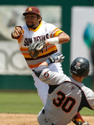 Pepperdine's Bryan Langlois (30) slides into a force out at second as Arizona State's Drew Stankiewicz (17) throws to first in the first inning in an NCAA college baseball tournament regional game Friday, May 30, 2014, in San Luis Obispo, Calif. The batter was safe at first.