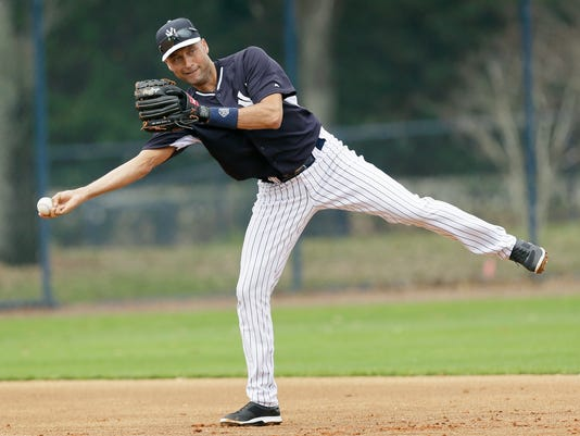 New York Yankees shortstop Derek Jeter throws to second base during spring training baseball practice Friday, Feb. 21, 2014, in Tampa, Fla. (AP Photo/Charlie Neibergall)