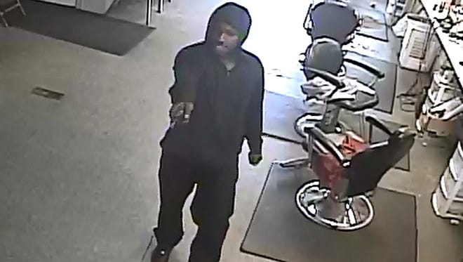 A photo of one of the two assailants in a robbery of a business near 10500 W. Chicago on Mar. 16. The assailants robbed and pistol-whipped a man inside.