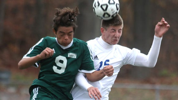 Cornwall's Mike Rosario, left, fights for the ball