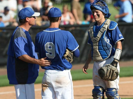 Coach Novak talks with his battery during 2012 GMCT final.