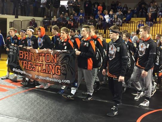 Brighton's wrestling team marches into McGuirk Arena