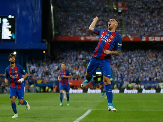 Barcelona's Paco Alcacer celebrates after scoring his team's third goal during the Copa del Rey final soccer match between Barcelona and Alaves at the Vicente Calderon stadium in Madrid, Spain, Saturday May 27, 2017. (AP Photo/Daniel Ochoa de Olza)