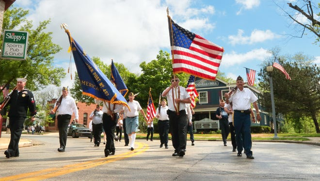 Members of the Mequon American Legion Post #457 and VFW Post 9207  head down Green Bay Road towards Main Street as they lead the annual Mequon-Thiensville Memorial Day parade in 2015. This year's parade will start at 10 a.m. from Grace Lutheran Church, 303 Green Bay Road, Thiensville.