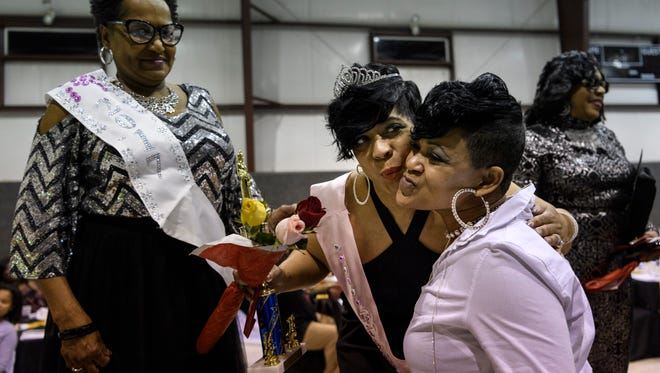 Last year's Glammother Rhonda Johnson (left) stands beside the newly crowned Glammother Michele Hardin (center) who receives congratulations from Wanda Brown (right) after the 5th Annual Glamorous Grandmother's Pageant at the Greater St. James Community Recreation & Education Center in Evansville, Ind., Sunday, Feb. 4, 2018.