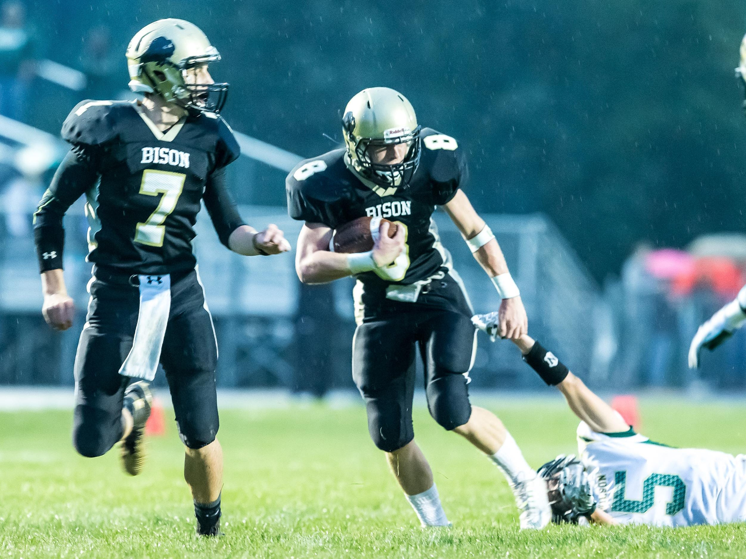 Buffalo Gap's Austin Comer pulls from the grasp of Wilson Memorial's Kyle Coombe during their game Friday.