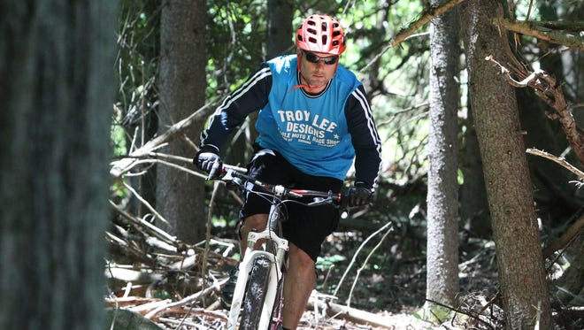 A file photo of Anthony DeVanzo rides on a new mountain bike trail on Clausland Mountain in Blauvelt June 10, 2016.