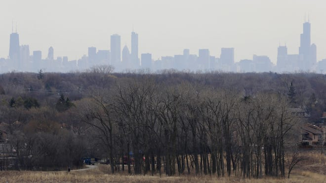 In this March 19, 2015, file photo, a thick haze of smog looms over the skyline of Chicago.