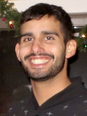 Kevin DeOliveira was found shot to death in his apartment