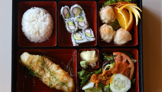 Bento Box clockwise from bottom left: Chilean Sea Bass, rice, California Roll, shumai and salad with ginger dressing. Monster Sushi is Morristown's newest restaurant specializing in sushi, sashimi, and other Japanese cuisine. Monster Sushi is located at 5 Pine St., Morristown, NJ. Tuesday, Oct. 21, 2015.  Special to NJ Press Media/Karen Mancinelli/Daily Record MOR 1028 TABLE Monster Sushi Morristown
