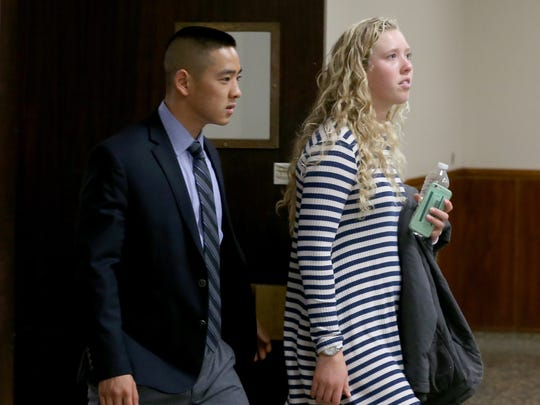 Charles Tan leaves court with Anna Valentine, a friend who testified in court.