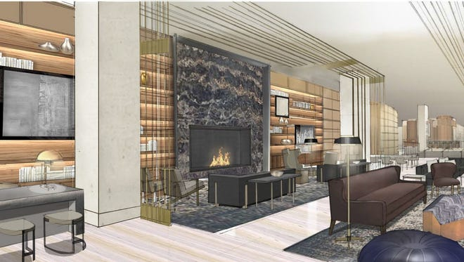 A Portoro marble fireplace flanked by bronze screens that will rise 17 feet will be in the lobby.