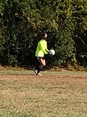 Keeper, Emily Donahue, getting ready to punt the ball after an excellent save.