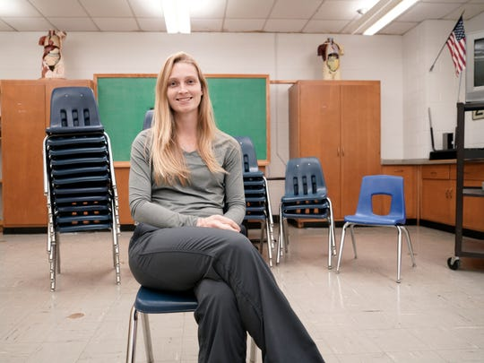 Ginny Hocker, a health and physical education teacher at Robert E. Lee High School who worked with her students on an anti-bullying project, sits for a portrait in her classroom on Monday, Nov. 30, 2015.