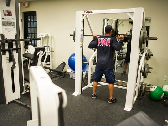 Mike Spicuzza works out at the North Collier Fire &