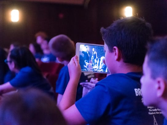 A camper snaps a shot on his iPad of Laura Osnes as