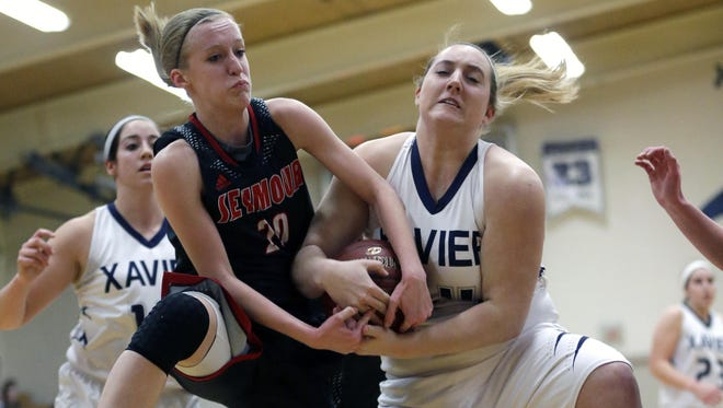 Seymour's Jenna Krause (left) battles for a rebound against Xavier's Karly Weycker during Thursday's game in Appleton.