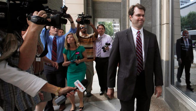 Martin Kent, chief of staff for former Virginia Gov. Bob McDonnell, walks into the federal courthouse in Richmond, Va. on Monday, Aug. 11, 2014, as the corruption trial of McDonnell and his wife, Maureen, enters its third week. The McDonnell's are charged in a 14-count indictment with accepting more than $165,000 in gifts and loans from the former CEO of a nutritional supplements company in exchange for promoting his products. They could face decades in prison if convicted. (AP Photo/Richmond Times-Dispatch, Bob Brown)