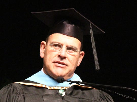 Fort Myers High School Principal David LaRosa addresses the Class of 2013 during the commencement ceremony held at the Lee Civic Center.