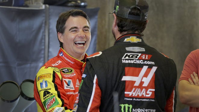 Sprint Cup Series driver Jeff Gordon (88) shares a laugh with Kurt Busch (41),right, just before practice for the Brickyard 400  Friday, July 22, 2016, afternoon at the Indianapolis Motor Speedway.